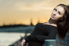 A young woman in dress leaning on railing Royalty Free Stock Photos