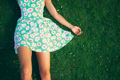Young woman in dress lying on gerass Royalty Free Stock Images