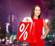 Young woman in dress with red shopping bags Royalty Free Stock Image