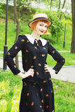 Young woman in dress retro style. Happy, smiling carefree young woman in a dress retro style, dancing swing, solo jazz and lindy hop. Pin-up girl in a hat and Royalty Free Stock Photo