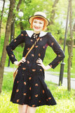Young woman in dress retro style. Happy, smiling carefree young woman in a dress retro style, dancing swing, solo jazz and lindy hop. Pin-up girl in a hat and Stock Images