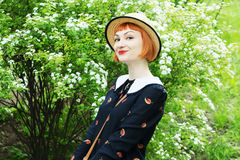 Young woman in dress retro style. Happy, smiling carefree young woman in a dress retro style, dancing swing, solo jazz and lindy hop. Pin-up girl in a hat and Royalty Free Stock Images