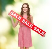 Young woman in dress with sale sign Royalty Free Stock Photo