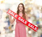 Young woman in dress with sale sign Stock Photography