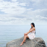 A young woman in a dress on a sea background Stock Photo