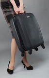 Young woman in a dress with suitcase Stock Photo