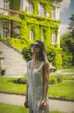 Young woman in dress and sunglasses stock image