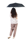 Young woman in  dress under an umbrella. Stock Images