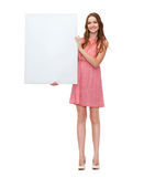 Young woman in dress with white blank board Stock Photo