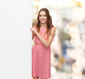 Young woman in dress with white blank board Stock Photography