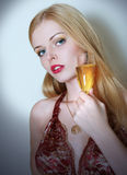 Young woman in dress with a wine glass Royalty Free Stock Image