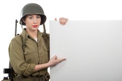 Young woman dressed in American ww2 military uniform showing empty blank signboard royalty free stock image