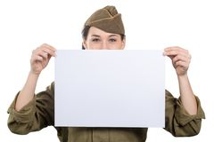 Young woman dressed in American ww2 military uniform showing empty blank signboard stock photos