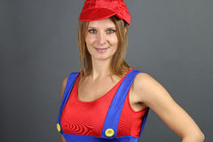 Young woman dressed as a character from video games. Beautiful woman dressed as a character from video games over a gray background Royalty Free Stock Image