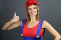 Young woman dressed as a character from video games. Portrait of a beautiful woman dressed as a character from video games over a gray background Stock Photos