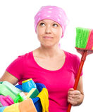 Young woman is dressed as a cleaning maid Royalty Free Stock Images