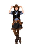 Woman dressed as a cowboy. Young woman dressed as a cowboy. Isolated on white royalty free stock image