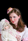 Young Woman dressed as doll. Young woman dressed in a doll costume Stock Photo