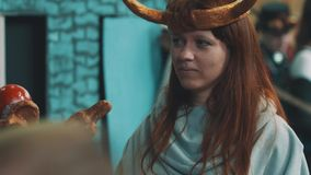 Young woman dressed as druid or magician character holding staff at festival stock video