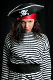 Young woman dressed as a pirate in a black hat royalty free stock photography