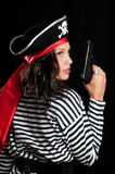 Young woman dressed as a pirate in a black hat hol Royalty Free Stock Photography