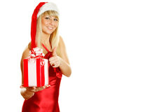 Young woman dressed as Santa with a gift. Royalty Free Stock Photography