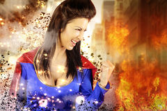 Young woman dressed as a superhero. Shows its power royalty free stock photos