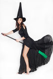 Young woman dressed as a witch on Halloween on an isolated background Royalty Free Stock Photography