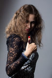 Young woman dressed in black is showing thumb up gesture Royalty Free Stock Photography