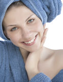 Young woman dressed blue bathrobe. And towel Royalty Free Stock Image