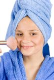 Young Woman Dressed Blue Bathrobe Putting Face-powder Royalty Free Stock Images