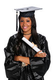 Young Woman Dressed in Graduation Gown Stock Photos