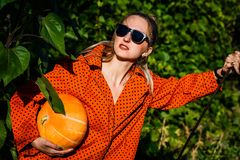 woman dressed for Halloween with pumpkin royalty free stock image