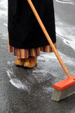 Young woman dressed in Holland attire, street cleaning Royalty Free Stock Photo
