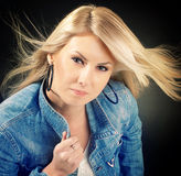 Young woman dressed in jean jacket Royalty Free Stock Images