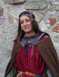 Young woman dressed in medieval costume at historical festival Royalty Free Stock Photo
