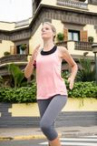 Young woman dressed in a running outfit stock image