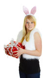 Young woman dressed a rabbit received gift Stock Images
