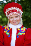 Young woman is dressed in the Russian national dress in summer p Stock Photos