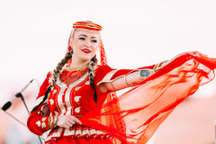 Young woman dressed in traditional folk costume dancing Azerbaijani Stock Images