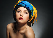 A young woman dressed in a turban Stock Images