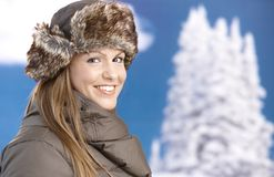 Young woman dressed up for winter fun smiling Royalty Free Stock Images