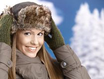 Young woman dressed up for winter fun smiling Stock Images