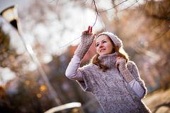 Young woman dressed in a warm woolen cardigan. Autumn/winter portrait: young woman dressed in a warm woolen cardigan posing outside in a city park Royalty Free Stock Photography
