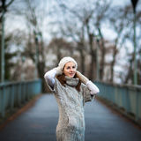 Young woman dressed in a warm woolen cardigan Royalty Free Stock Photography