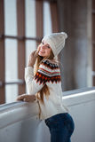 Young woman dressed in a warm woolen cardigan Stock Images