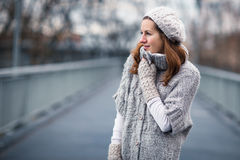 Young woman dressed in a warm woolen  cardigan. Autumn/winter portrait: young woman dressed in a warm woolen cardigan posing outside in a city park Stock Photography