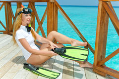 The young woman dresses equipment for underwater s. Wimming. Portrait in a sunny day royalty free stock photography