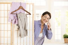 Young woman dressing in the morning Royalty Free Stock Photo