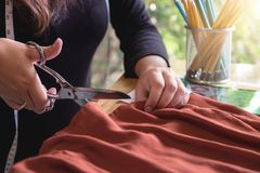 Young woman dressmaker or designer working as fashion designers Royalty Free Stock Photo
